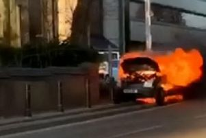 A flaming van was spotted rolling down the road in Luton
