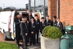 Pupils from CHSB with Amar Azam of the Luton Foodbank, and Aabid Khan, the lead teacher who worked with the boys on the project.