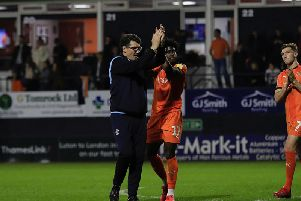 Mick Harford applauds the Town fans on Tuesday night