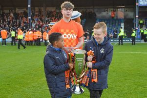 Daniel Humphreys accompanies the two under-8 players. Photo: LTFC/Gareth Owen