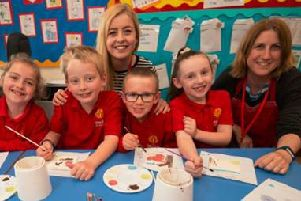 Tallulah Craft Studios member (right) with Slip End teacher Ciara Lawn (centre) and pupils