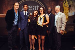 Encina (with trophy) and Samuel (second left) at the ceremony.
