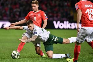 James Collins is sent tumbling against Switzerland on Tuesday night