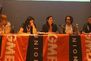 Sarah Owen (centre) at a GMB conference