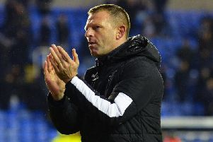 Hatters boss Graeme Jones applauds the Town fans at Reading