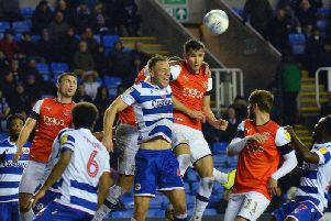 Dan Potts goes up to try and win a header against Reading