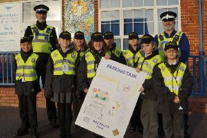 PCSOs Neal Wallace and Neil Harrison with some of Market Rasen's mini police and the poster they designed. EMN-190115-071412001