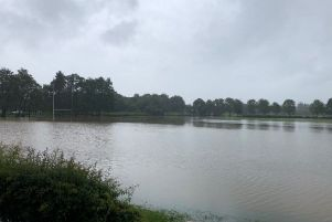 The flooded sports field at De Aston School. EMN-191206-103028001