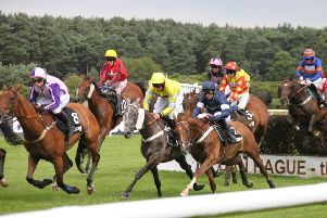 The field clear a fence in the feature Betway Summer Plate Handicap Chase. Picture:  Peter Thompson EMN-190722-093818002