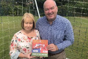 Robert Clark, Studio Manager, and Joanna Taylor, Account Manager,'the core project team from Systematic supporting the design and print of the new book EMN-190719-070833001