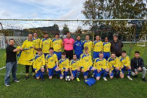 Sponsor Paul Ryan with the new-look Market Rasen Town first team EMN-191014-125920002