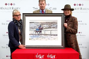 Sally and Simon Jones pictured with Di Marshall (right) and the painting. Credit: Mick Atkins Photography