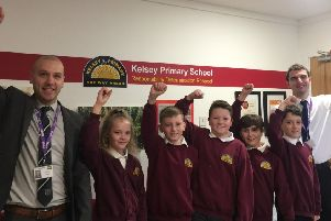 Mr Cook, left, and Mr Brown with some of the current year six pupils