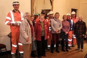 Members of Holton le moor WI with the workmen at tea time