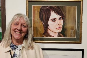 June Holman with her mixed media portrait of Cara Delevingne