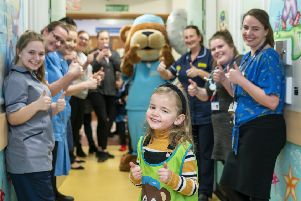 Ava at Scunthorpe hospital's Disney Ward with her family, staff and Scrubs the Bear.''Credit: Calvin Taylor Lee of One Click Photographer.