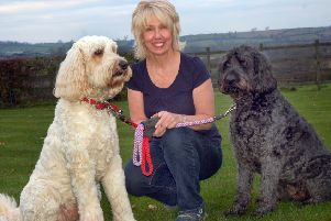Dog trainer and behaviourist Lynne Marshall with Goldendoodle Teddy  and Labradoodle Bonnie EMN-150515-091542001