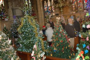 Christmas trees galore in St Mary's Church PHOTO: Tim Williams