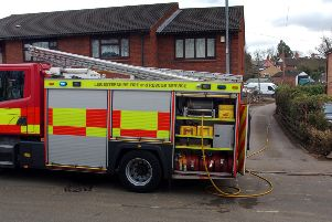 A fire crew from Melton at the scene of a garage blaze i Ankle Hill, Melton. Picture: Tim Williams