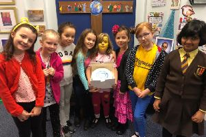 Tabitha Pritchard and fellow pupils at St Francis Primary School, Melton, during the cake sale she organised for a premature babies charity EMN-181121-171723001