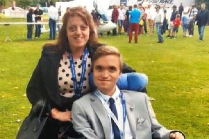 James Everett, who has passed away at the age of 27 after a brave battle with muscular dystrophy, with his mum, Angie Gillespie EMN-180512-111248001