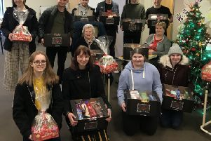 College students present their Christmas hampers at Gloucester House, Melton PHOTO: Supplied