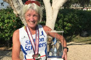 Julie Bass with her latest trophy - after winning the grandmaster (over 60s) first prize at the Dubai Half-Marathon EMN-181221-135812002