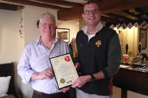 Robert Smith, landlord at The Bell pub at Frisby, received a coveted merit award from Melton CAMRA chairman Kevin Billson EMN-190301-155305001
