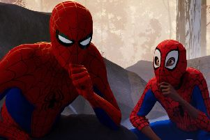 (Left to right): Peter Parker (voiced by Jake Johnson) and Miles Morales (voiced by Shameik Moore) PHOTO: PA Photo/CTMG, Inc./Sony Pictures Animation