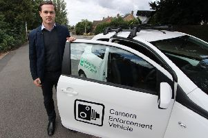 Councillor Blake Pain with the camera enforcement vehicle being used by Leicestershire County Council to clamp down on motorists who park irresponsibly outside schools EMN-190213-141250001
