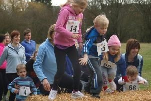 Thrussington Fun Run - parents and toddlers jump the straw bale in the first race PHOTO: Tim Williams EMN-190219-180438002