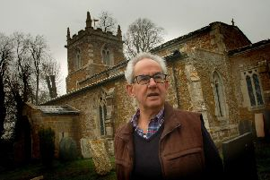 Churchwarden Neil Rogers outside St Denys Church. Goadby Marwood, which had its roof lead stripped by thieves EMN-190103-094141001