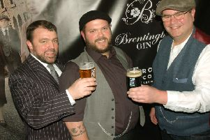 Round Corner brewery's Combie Cryan and Colin Paige with Brentingby Gin distiller Bruce Midgley (centre) PHOTO: Tim Williams