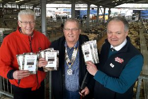 Hugh Brown (right), CEO of Melton Mowbray Market and founder of its operator Gillstream Markets, with local historian Derek Simmonds (left) and Jim Schofield, from Melton & Belvoir Rotary Club, holding the new 150th anniversary brochures EMN-191203-163357001