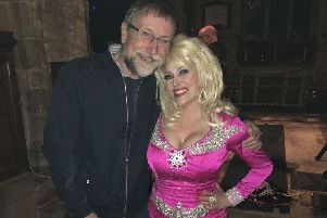 Brian Keevil, chairman of Hose Village Hall committee with Kelly O'Brien as Dolly Parton PHOTO: Supplied