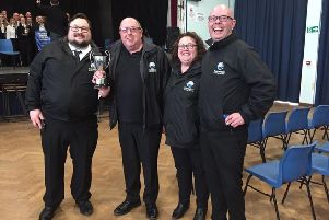 With the trophy are (left to right): Henry Dunger, Dennis Powell, Wendy Rid and Chris Shilam PHOTO: Supplied
