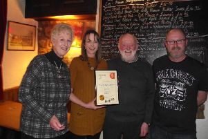 Landlords Jeff and Carol Evans, and daughter Lynn, receive the award for top Melton and district pub from Melton CAMRA's Kevin Baker (right), for the third time in five years EMN-190104-100359001