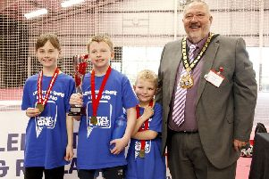 Ab Kettleby Primary School's new age kurling winners with Leicestershire County Council chairman Ozzy O'Shea EMN-190304-105623002