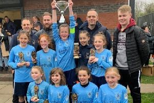 Asfordby FC Gems lift the League Cup aloft after a stunning year together EMN-190416-123034002