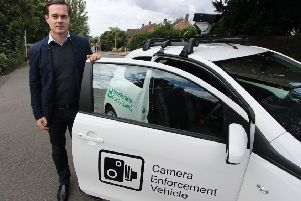 Councillor Blake Pain with the camera enforcement vehicle being used by Leicestershire County Council to clamp down on motorists who park irresponsibly outside schools EMN-190513-140742001
