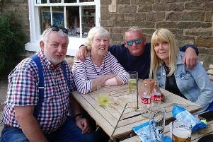 Janet Jones (second from left), who was missing for nearly 12 hours, pictured back with family members on Sunday, from left, husband Ellis, son-in-law Ian Young and daughter Clare Young EMN-190107-142927001