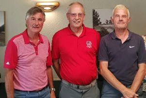 Pete Rayers and Brian Shilham, two-thirds of the winning team, with senior captain Dick Chapman (centre) EMN-190718-163110002