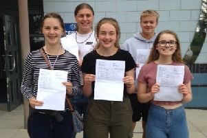 Priory Belvoir Academy students celebrate their GCSE results, from left,  Charlotte Newport, Theo Tucker, Emma Coffey, Sam Murray (head boy), Ellie Sarginson (head girl). EMN-190822-164639001