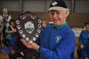 First recipient of the Pat Bishop Volunteer of the Year award, Albert Rutledge, with the shield presented by the RDA Mount Group at their Somerby Equestrian Centre base EMN-190110-122032001