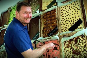 The Chocolate House's Paul Fowler and his tempting chocolate wall PHOTO: Tim Williams