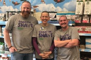 From left, employees at Melton's Pets At Home, Graham Shipton, Helen Rigby and Xander Ambrose, after having their heads shaved for their fundraising effort in support of colleague Lisa Kidd EMN-191030-104510001