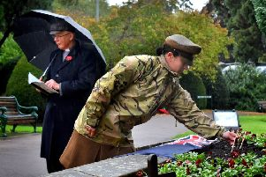 Major Carolyn Bates representing the Defence Animal Training Regiment plants a crossat the Memorial Gardens during a service to launch the 2019 Poppy Appeal in Melton EMN-191029-151743001