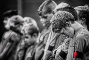 Young footballers of Asfordby FC Under 9s pay their respects during a minute's silence before a match on Sunday'PHOTO PHIL JAMES EMN-191111-120920001