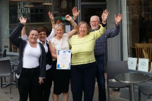 Proprietor Lynne Sharpe with staff and regular customers Jeff Wakeling and Rita Weatherhead celebrate the cafe's prestigious Good Food Award EMN-191119-154108001