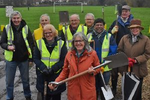 Melton Rotary President Adrienne Holland and the tree-planting crew in Egerton Park EMN-191125-103758001
